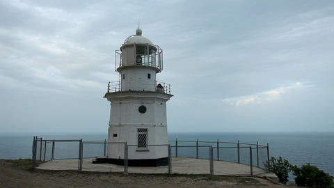 Lighthouse. The movement of clouds on the mountain Footage