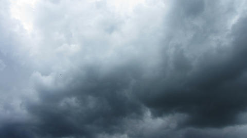 Dark Storm Clouds Are Moving Fast At Viewer - Time stock footage