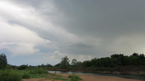 landscape with rain clouds over river timelapse Stock Video Footage