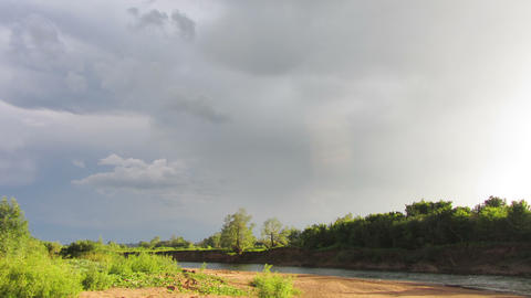 landscape with rain clouds over river timelapse 4k Footage