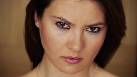 Angry young woman staring at camera Stock Video Footage
