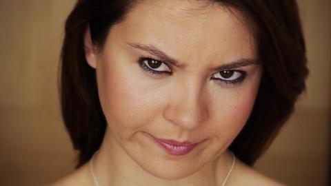 Angry young woman staring at camera Footage