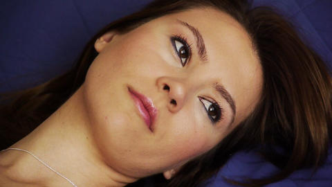 Depressed young woman lying on back Stock Video Footage