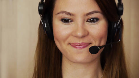 Young female call centre agent Stock Video Footage