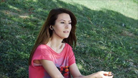 Young woman listening to music Stock Video Footage