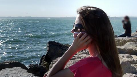 Girl phone talking coast sea smile Stock Video Footage