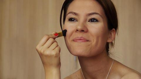 Beautiful girl makeup foundation Stock Video Footage