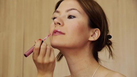 Beautiful girl makeup lipstick Footage