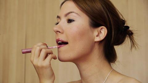 Beautiful girl makeup lipstick Stock Video Footage