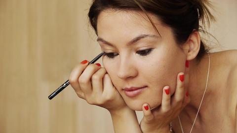 Beautiful girl makeup eyeliner Stock Video Footage