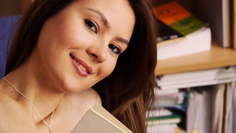 Girl smiling library books Stock Video Footage