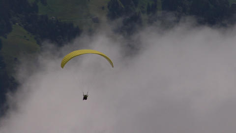 paraglider zoom out mountain Stock Video Footage