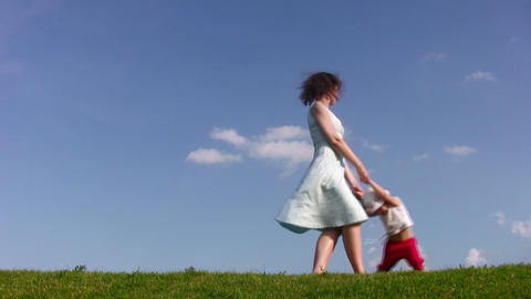 rotating mother with little girl on meadow Stock Video Footage