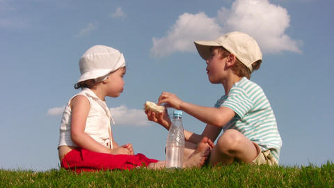 children with food on meadow 2 Stock Video Footage