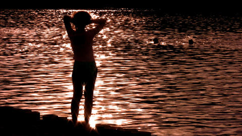 silhouette woman on water alone Stock Video Footage