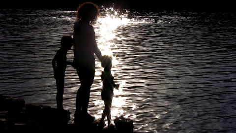 silhouette mother with children on water Stock Video Footage