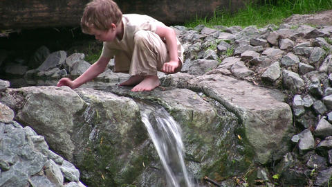 child play on small waterfall Stock Video Footage