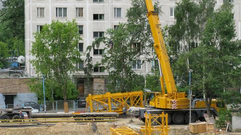 crane construction by cranmobile time lapse Stock Video Footage