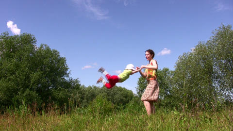Mother rotate little girl Stock Video Footage