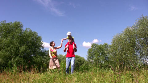 Family with daughter on sholders Stock Video Footage