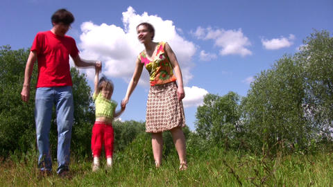 Family carry jumping daughter Stock Video Footage
