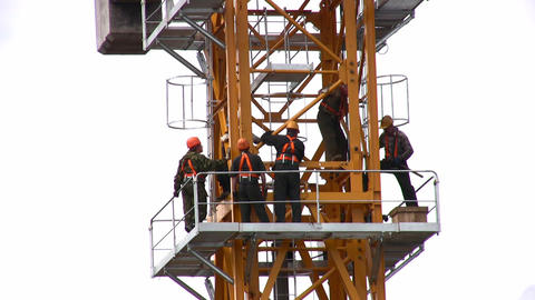 People on high building crane Stock Video Footage