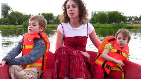 mother with children on boat 2 Stock Video Footage