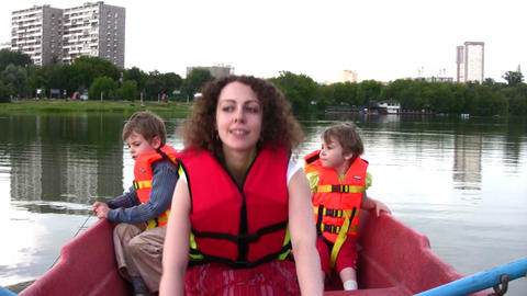 mother with children on boat 4 Stock Video Footage