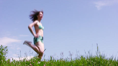 Marching woman on grass Stock Video Footage