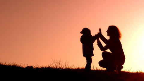 mother with child sunset, red version Stock Video Footage