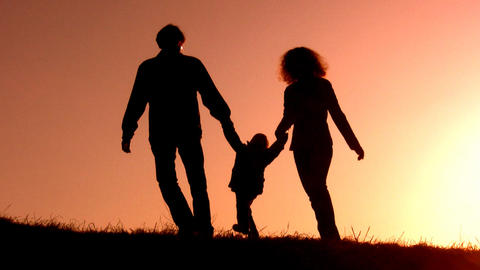 family with little girl sunset silhouette Footage