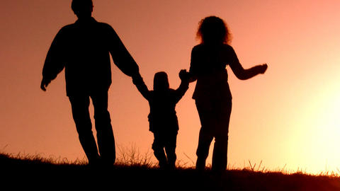 family with little girl sunset silhouette Stock Video Footage