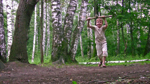 boy on swing in park Stock Video Footage