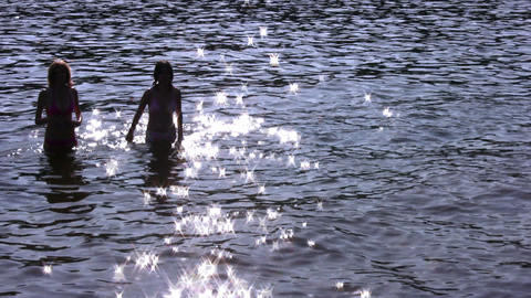running girls silhouette in water Stock Video Footage