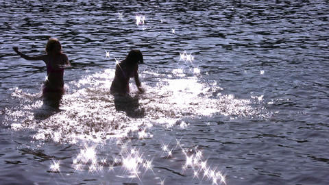running girls silhouette in water Footage