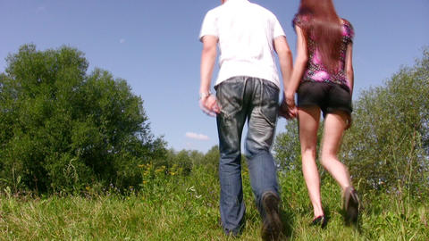 walking couple on grass Footage