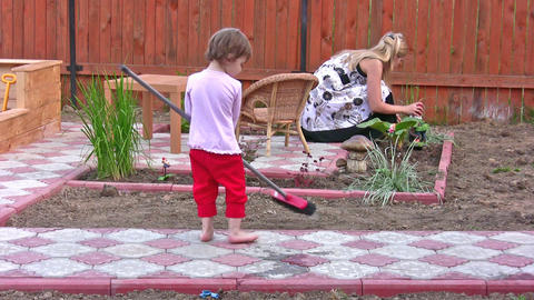 mother with daughter cleaning home yard Stock Video Footage