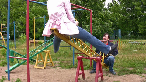 couple on seesaw Stock Video Footage