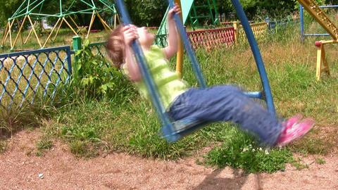 little girl on swing board Footage