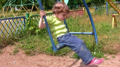 little girl on swing board Stock Video Footage