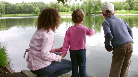 mother with little girl on pond Stock Video Footage