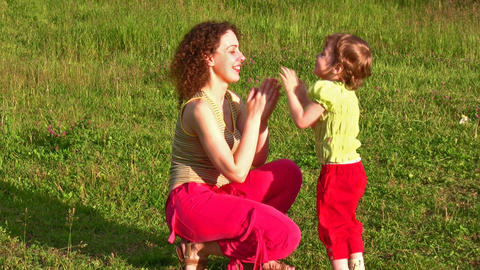 mother with little girl on grass Stock Video Footage