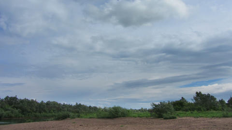 landscape with rain clouds over river timelapse Footage