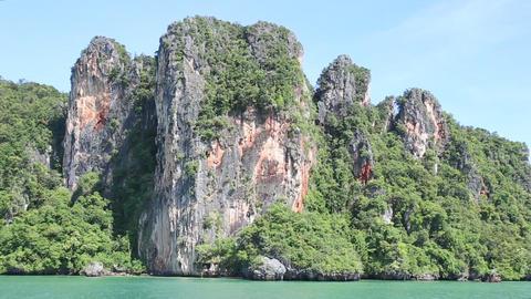 rocky in blue tropical ocean Stock Video Footage