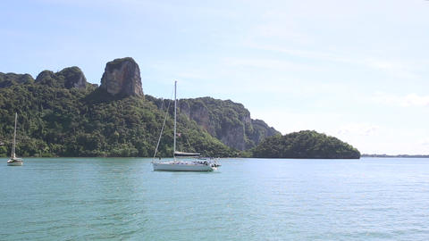 sailboat anchored in ropical island Footage