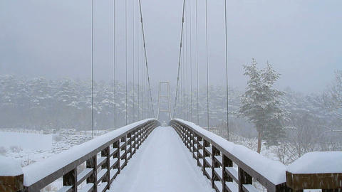 Suspension bridge in the snowfall Live Action