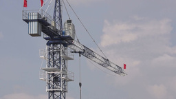 Building Crane Works At The Construction Site stock footage