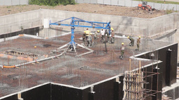 Workers on a construction site of new building Stock Video Footage