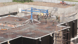 Workers on a construction site of new building Footage
