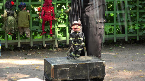 Doll a puppet on the strings. 4K Stock Video Footage